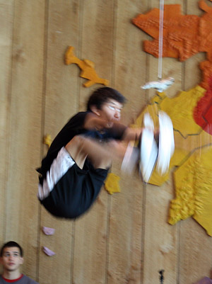 An Athabaskan youth shows his nimble abilities in the native warrior games