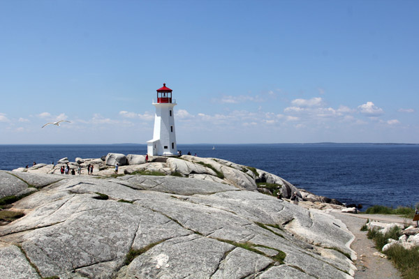 "The famous lighthouse at Peggy's Cove, sitting atop ""erratic"" rock formations"