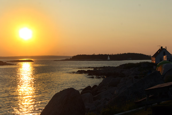 Sunset at Peggy's Cove. Note the lighthouse at right.