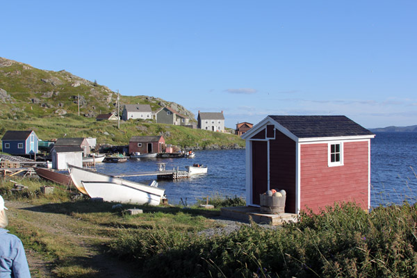 "The red building at right is a ""stage."" What we call piers are ""flakes"" up here.  Fishing villages are quaint to tourists, but it's the way of life that has been going on for 400 years for the locals."