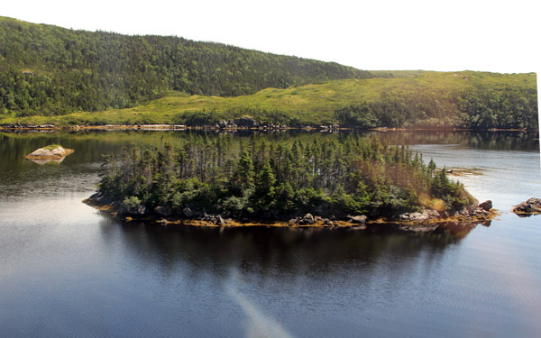 Ponds and hills form the beautiful serene countryside of Newfoundland