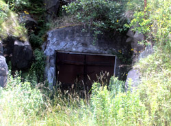 One of the caves where wine was stored is sealed behind a steel door.