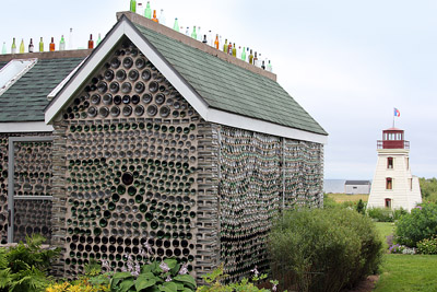 The Bottle House with the Lighthouse Overlooking Egmont Bay