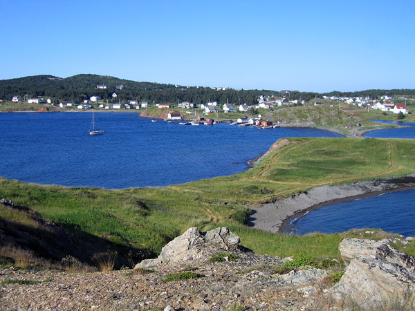 A typical Newfoundland village hugging the bright blue waters